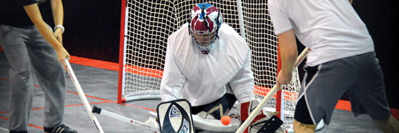 Floor hockey goalie makes a save